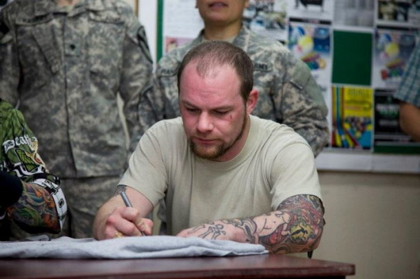 photograph-Chris-Kael-FiveFingerDeathPunch-in-Kuwait-2012-soldiers